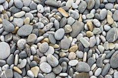 Σύσταση υποβάθρου με τις στρογγυλές πέτρες χαλικιών Στοκ φωτογραφίες με δικαίωμα ελεύθερης χρήσης