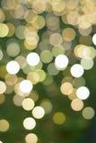 Σύσταση υποβάθρου των πράσινων χρωματισμένων θολωμένων διακόσμηση φω'των Χριστουγέννων Στοκ φωτογραφία με δικαίωμα ελεύθερης χρήσης