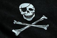 Σύσταση υφάσματος της σημαίας πειρατών που κυματίζει στον αέρα, το σύμβολο πειρατών γρύλων βαμβακερού υφάσματος, το χάκερ και το  Στοκ εικόνες με δικαίωμα ελεύθερης χρήσης
