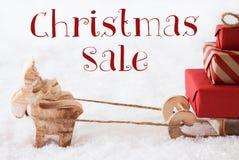 Τάρανδος με το έλκηθρο στο χιόνι, πώληση Χριστουγέννων κειμένων Στοκ Εικόνες