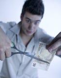 τέμνοντα χρήματα αγοριών Στοκ Φωτογραφία