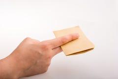 Τέμνον σημειωματάριο χεριών Στοκ φωτογραφία με δικαίωμα ελεύθερης χρήσης