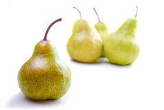 Τέσσερα αχλάδια που απομονώνονται στο λευκό Στοκ εικόνα με δικαίωμα ελεύθερης χρήσης