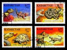 Τέσσερα γραμματόσημα που τυπώνονται στο Καζακστάν από τα ερπετά serie, circa 1994 στοκ φωτογραφίες