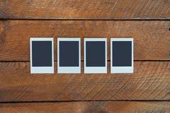 Τέσσερα κενά στιγμιαία πλαίσια φωτογραφιών με το διάστημα αντιγράφων Στοκ Εικόνα