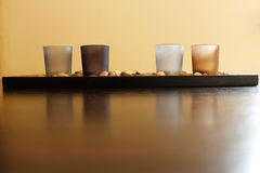 Τέσσερα κεριά στις πέτρες Στοκ φωτογραφία με δικαίωμα ελεύθερης χρήσης