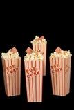 Τέσσερα κιβώτια Popcorn με τα εισιτήρια κινηματογράφων Στοκ Φωτογραφίες
