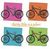 Τέσσερα περιγραμματικά ποδήλατα χρωμάτων Στοκ Εικόνα