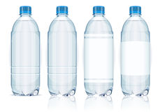 Τέσσερα πλαστικά μπουκάλια με τις ετικέτες. Στοκ φωτογραφίες με δικαίωμα ελεύθερης χρήσης
