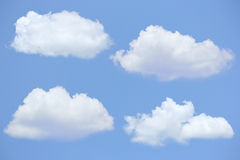 Τέσσερα σύννεφα με το μπλε ουρανό Στοκ Εικόνες