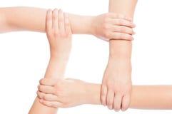 Τέσσερα χέρια που ενώνονται Στοκ Φωτογραφία