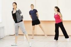 Τέσσερις άνθρωποι στη γυμναστική Στοκ Φωτογραφία
