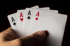Τέσσερις άσσοι υπό εξέταση για το τυχερό παιχνίδι παιχνιδιού Στοκ Εικόνα