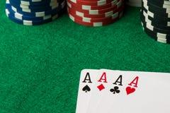 Τέσσερις από άσσους τους καλούς πόκερ χεριών στοκ εικόνες