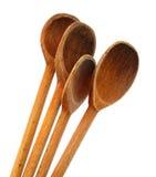 Τέσσερις ξύλινες κουτάλες που απομονώνονται στην άσπρη ανασκόπηση Στοκ Εικόνες