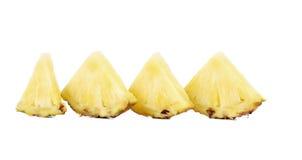 Τέταρτα του ανανά φετών σε μια σειρά. Στοκ εικόνες με δικαίωμα ελεύθερης χρήσης