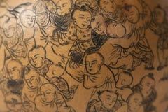 Τέχνη της Κίνας - μια κολοκύθα με την ανακούφιση σε το στοκ εικόνες