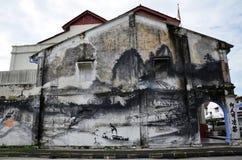 Τέχνη τοίχων «εξέλιξης» που χρωματίζεται από το διάσημο καλλιτέχνη, Ernest Zacharevic σε Ipoh Στοκ Εικόνα