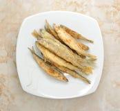 Τήξη ψαριών που τηγανίζεται σε ένα πιάτο Στοκ εικόνες με δικαίωμα ελεύθερης χρήσης