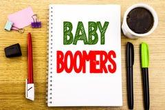 Τίτλος κειμένων γραψίματος χεριών που παρουσιάζει γενιές του baby boom Επιχειρησιακή έννοια τη δημογραφική παραγωγή που γράφεται  Στοκ Φωτογραφία