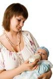 ταΐζοντας μητέρα μωρών Στοκ Εικόνες