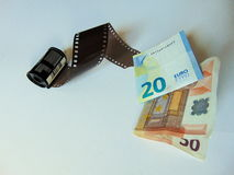Ταινία καμερών που μετατρέπεται σε χρήματα   έννοια stockphotography Στοκ Φωτογραφία