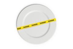Ταινία κινδύνου στο πιάτο Στοκ φωτογραφία με δικαίωμα ελεύθερης χρήσης