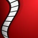 Ταινία στο κόκκινο υπόβαθρο Στοκ εικόνες με δικαίωμα ελεύθερης χρήσης
