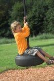 ταλάντευση παιδικών χαρών Στοκ φωτογραφίες με δικαίωμα ελεύθερης χρήσης
