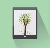Ταμπλέτα Eco με το δέντρο Στοκ Φωτογραφίες