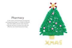 Ταμπλέτες με μορφή χριστουγεννιάτικου δέντρου και λέξεων κάτω από το στοκ εικόνα