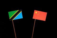 Τανζανική σημαία με την κινεζική σημαία στο Μαύρο Στοκ εικόνες με δικαίωμα ελεύθερης χρήσης
