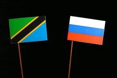 Τανζανική σημαία με τη ρωσική σημαία στο Μαύρο Στοκ φωτογραφίες με δικαίωμα ελεύθερης χρήσης