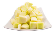 Ταξινομημένα δάγκωμα φρούτα δροσιάς μελιού σε ένα πιάτο Β Στοκ εικόνα με δικαίωμα ελεύθερης χρήσης