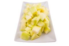 Ταξινομημένα δάγκωμα φρούτα δροσιάς μελιού σε ένα πιάτο Ι Στοκ εικόνα με δικαίωμα ελεύθερης χρήσης