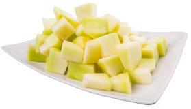 Ταξινομημένα δάγκωμα φρούτα δροσιάς μελιού σε ένα πιάτο VI Στοκ Φωτογραφία