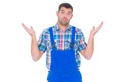 Ταραγμένο handyman δόσιμο δεν ξέρω τη χειρονομία Στοκ φωτογραφία με δικαίωμα ελεύθερης χρήσης