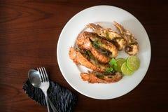 Ταϊλανδικά τρόφιμα: ανακατώνω-τηγανισμένος αστακός βράχου με τα τσίλι, το σκόρδο και Tha Στοκ φωτογραφίες με δικαίωμα ελεύθερης χρήσης