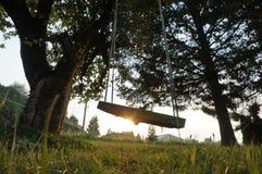 Ταλάντευση στο ηλιοβασίλεμα Στοκ Εικόνα