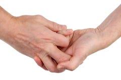 Τα άτομα παραδίδουν την πάλη συνδυάζονται με τα δάχτυλα απομονωμένος στοκ φωτογραφία