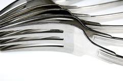 Τα δίκρανα τακτοποίησαν σωρηδόν στον πίνακα κουζινών Στοκ Εικόνα