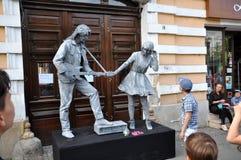 Τα αγάλματα διαβίωσης Beeldje ο κόσμος υπερασπίζονται των αγαλμάτων διαβίωσης Στοκ Εικόνες