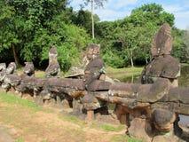 Τα αγάλματα σε Angkor Wat, Καμπότζη, Siem συγκεντρώνουν Στοκ Εικόνες