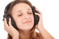 τα ακουστικά κοριτσιών &omicro Στοκ Φωτογραφίες