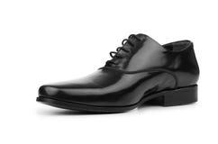 Τα αρσενικά μαύρα παπούτσια που απομονώνονται στο λευκό Στοκ Φωτογραφία