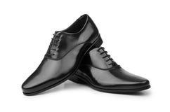 Τα αρσενικά μαύρα παπούτσια που απομονώνονται στο λευκό Στοκ Φωτογραφίες
