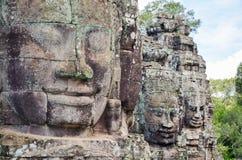 Τα αρχαία πρόσωπα πετρών του ναού Bayon, Angkor, Siem συγκεντρώνουν, Καμπότζη 1 Σεπτεμβρίου 2015 Στοκ Εικόνα