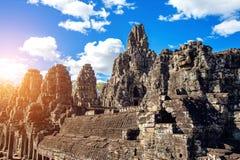 Τα αρχαία πρόσωπα πετρών του ναού Bayon, Angkor Wat, Σιάμ συγκεντρώνουν Στοκ Εικόνες