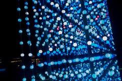 Τα αφηρημένα σημεία του φωτός, αφηρημένο υπόβαθρο τεχνολογίας φαντασίας, ελαφριές χρωματισμένες σφαίρες σε ένα διάστημα άναψαν δι Στοκ Εικόνες