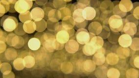 Τα αφηρημένα υπόβαθρα bokeh χρωματίζουν κίτρινος και χρυσός απόθεμα βίντεο
